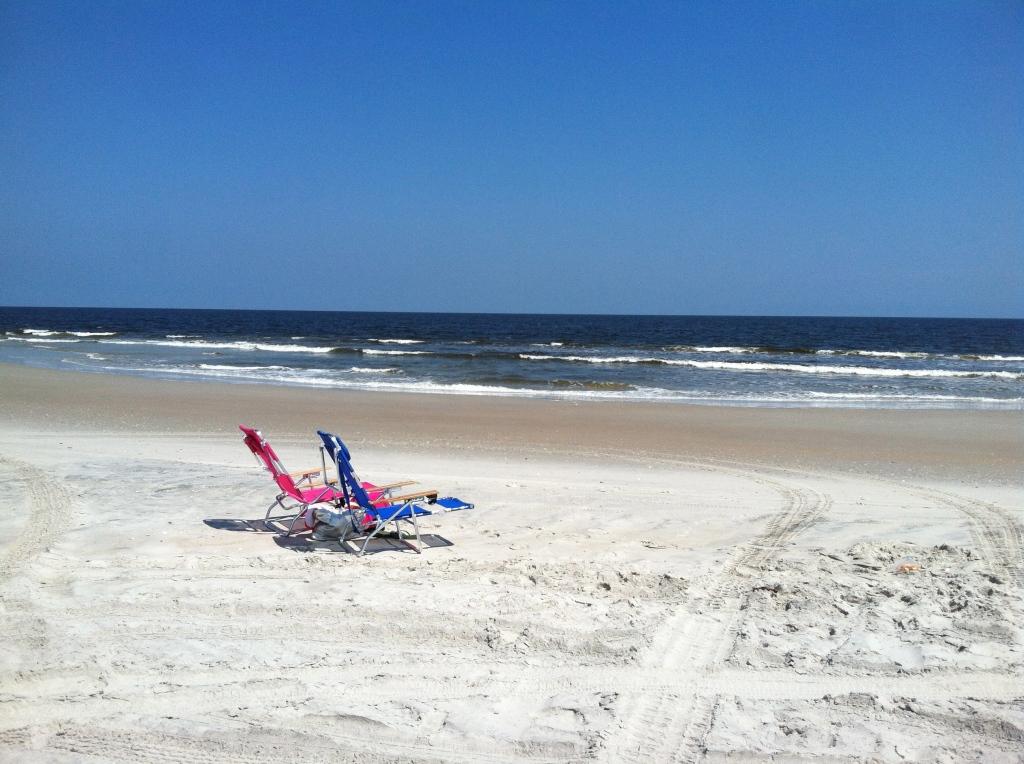 2 beach chairs on the beach shore
