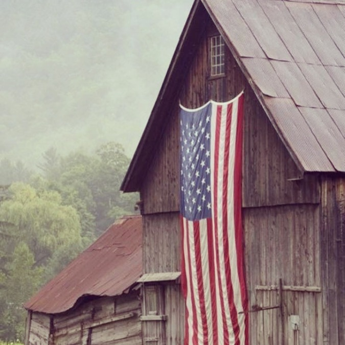 Old barn with American flag