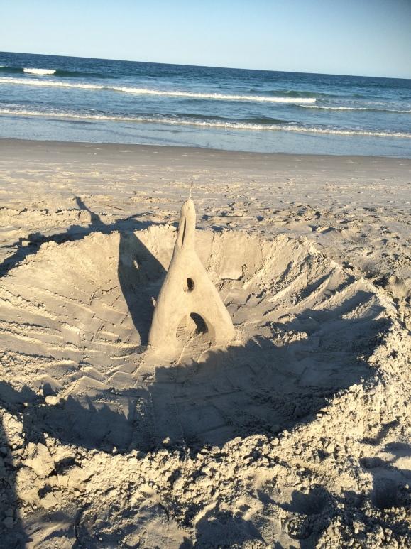 Eiffel tower sand sculture on the beach