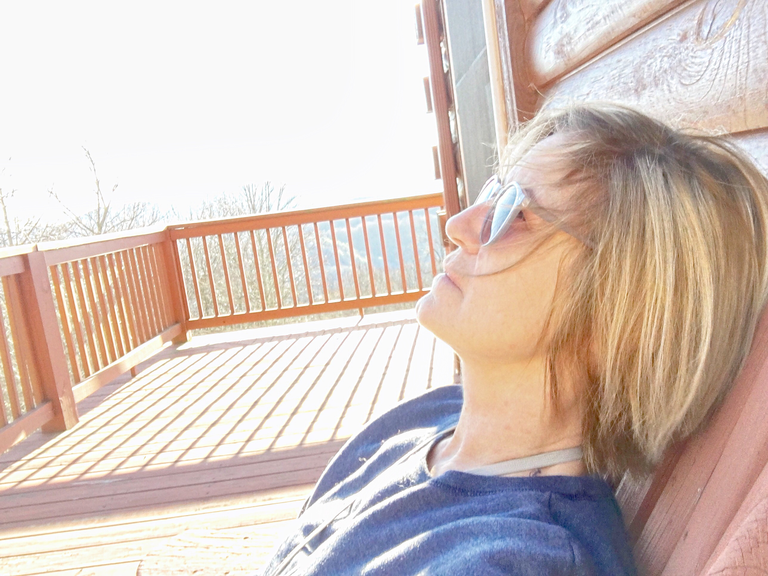 Daydreaming, cabin deck, Donna George relaxing
