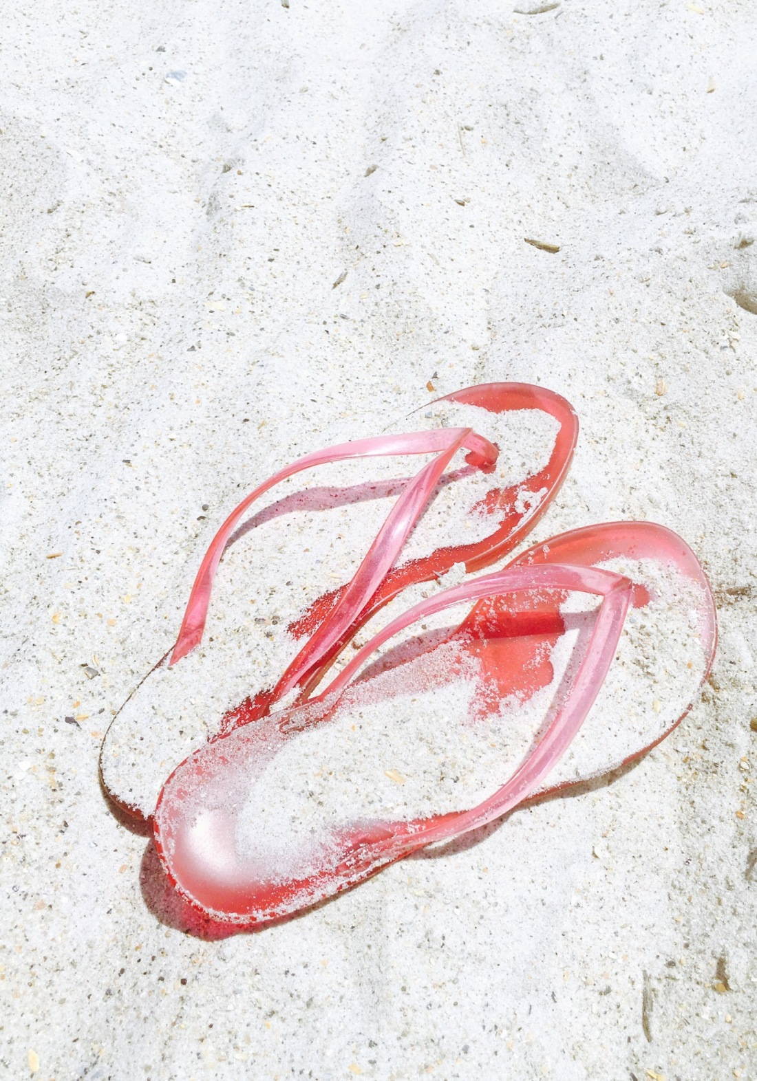 Pink Jelly Flipflops in the sand